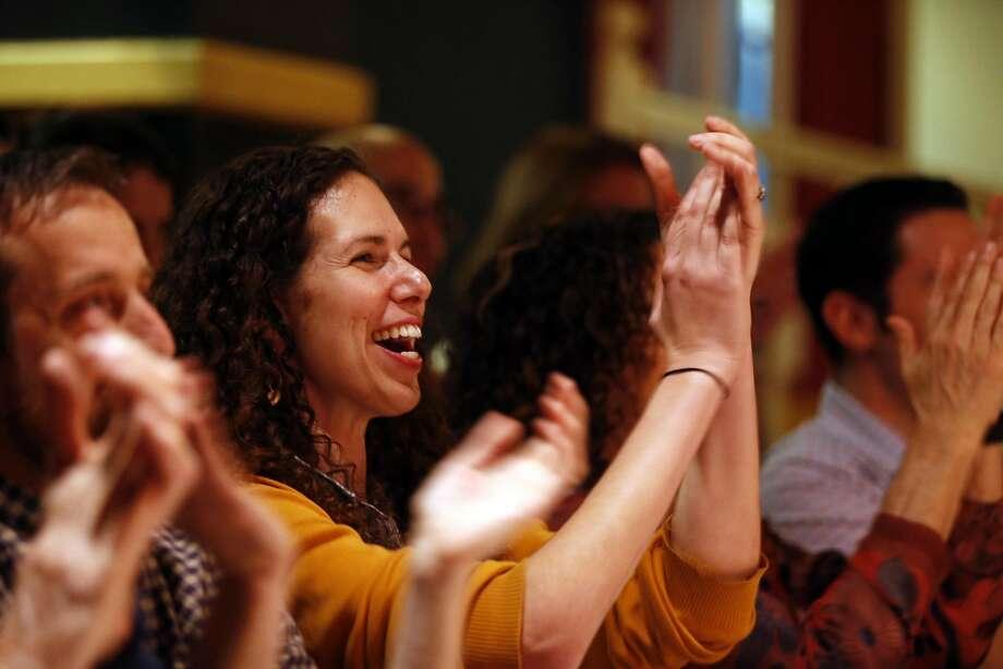 Co-producer Dr. Ali Block applauds storyteller Dr. Grant Smith. Photo: Scott Strazzante, The Chronicle