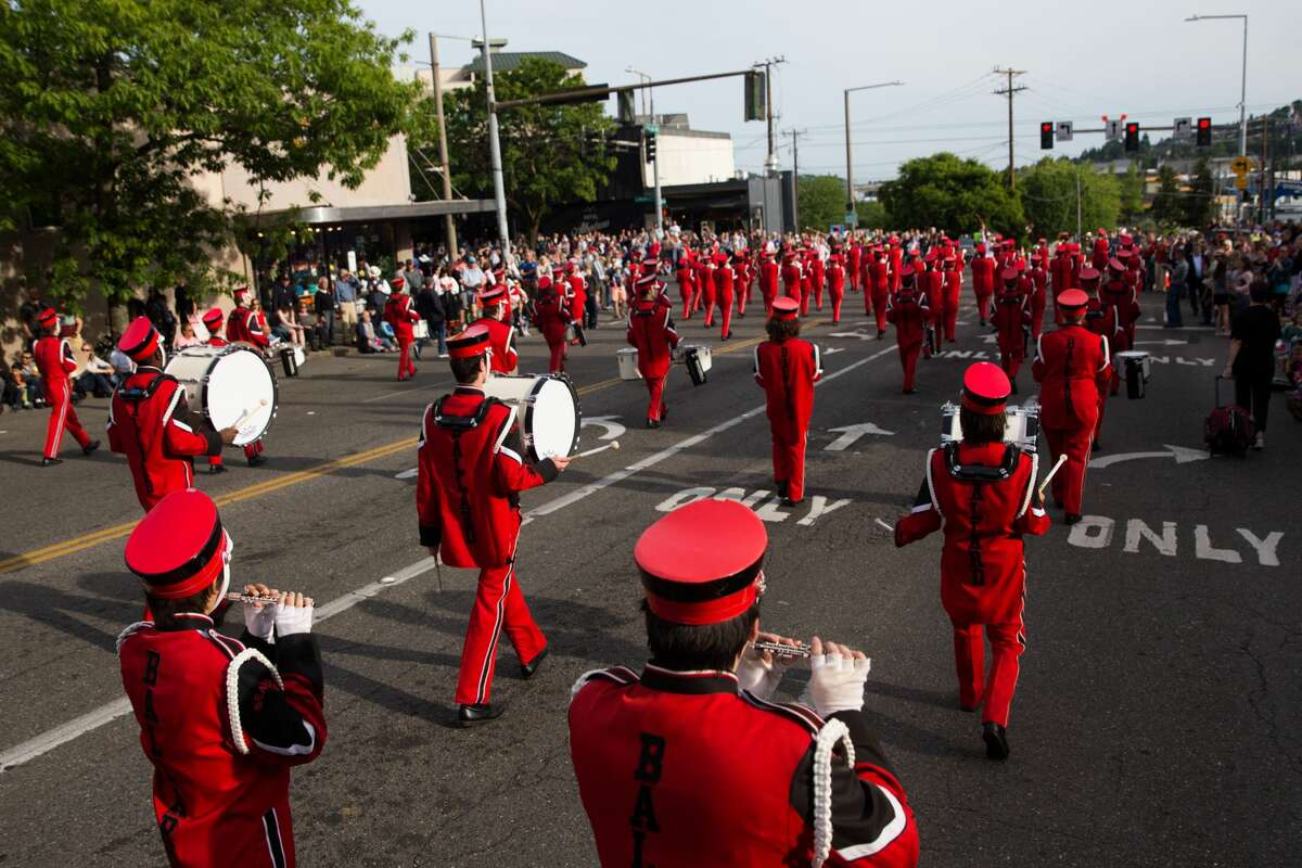 The Ballard High School band performs for thousands during the annual Syttende Mai parade through Ballard, Tuesday, May 17, 2015. The parade is part of Norwegian Constitution Day and is heralded as one of the largest celebrations outside of Oslo, and Ballard High School's presence there is one of the parade's many traditions, as they did here in 2017. (GRANT HINDSLEY, seattlepi.com)