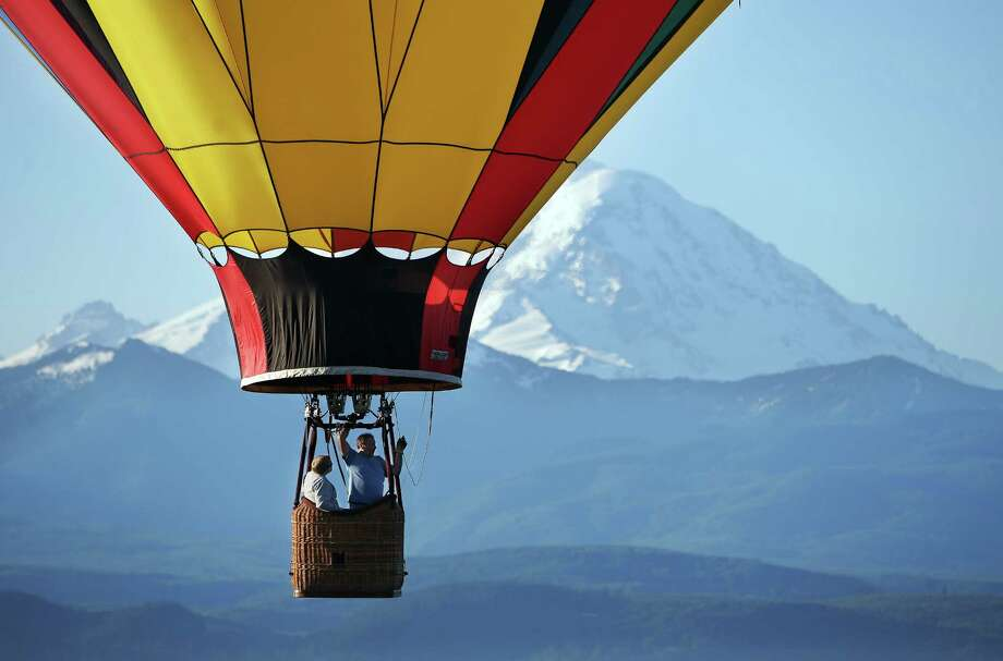 Hot air balloons fly near Mount Rainier in Enumclaw early Friday, May 13, 2016. Photo: GENNA MARTIN, SEATTLEPI.COM / SEATTLEPI.COM