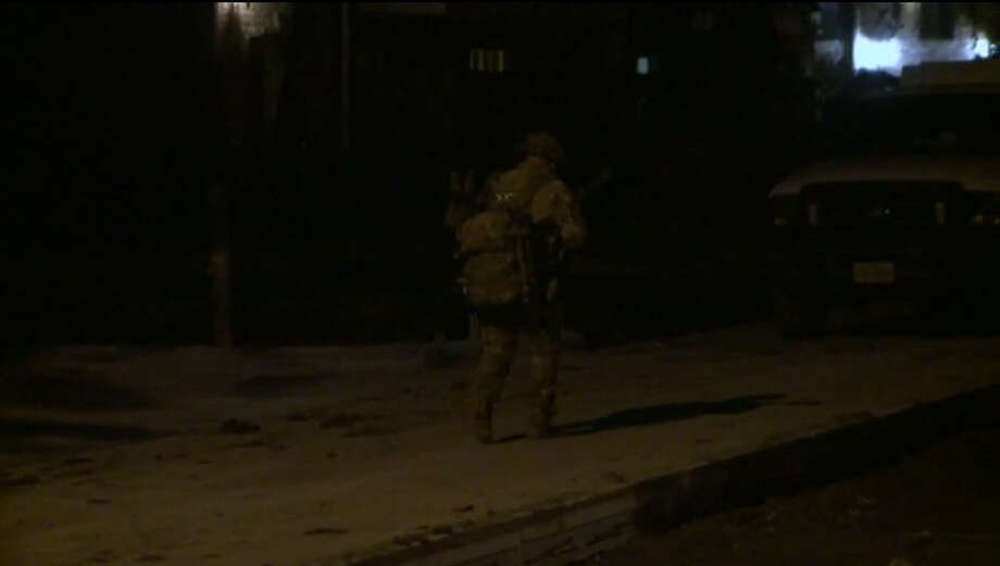 A woman, man and baby spent a scary hour hiding in a closet Tuesday night when an suspect in their apartment fired gunshots, refused to let them leave and held police at bay in southeast Houston. Photo: Metro Video