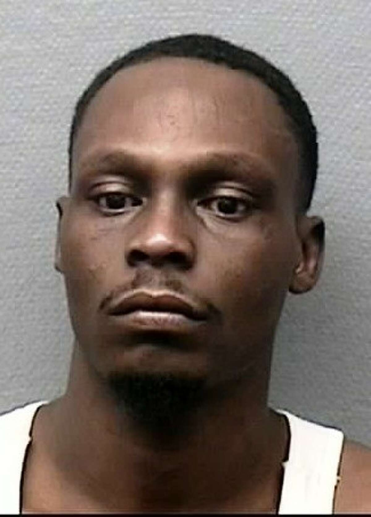 Che Lajuan Calhoun, 31, is charged with murder in the stabbing death of Josue Flores, 11, as the boy walked home from school Tuesday, May 17, 2016. (HPD)