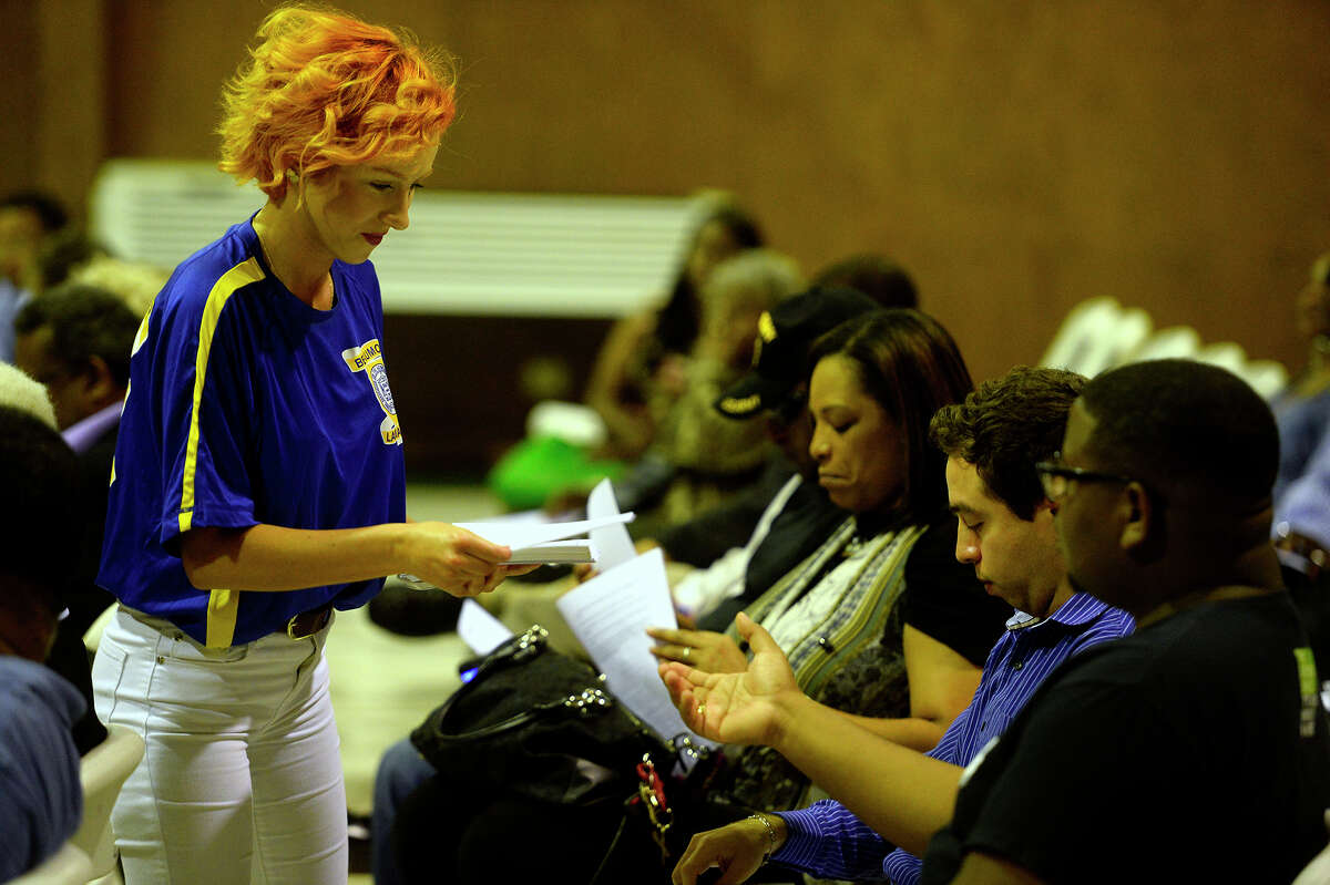Shyann Caudel, with the Lamar University NAACP chapter, hands out information during an NAACP meeting Tuesday evening about mentoring the youth. Photo taken Tuesday 5/17/16 Ryan Pelham/The Enterprise
