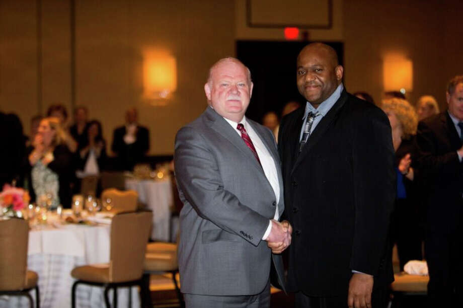 Photo caption: Marian Nowak Award winner Paul Pryce (right) congratulated by Norman Roth, Greenwich Hospital president, at the Employee Service Awards Dinner held on May 12 at the Greenwich Hyatt. Photo: / Contributed