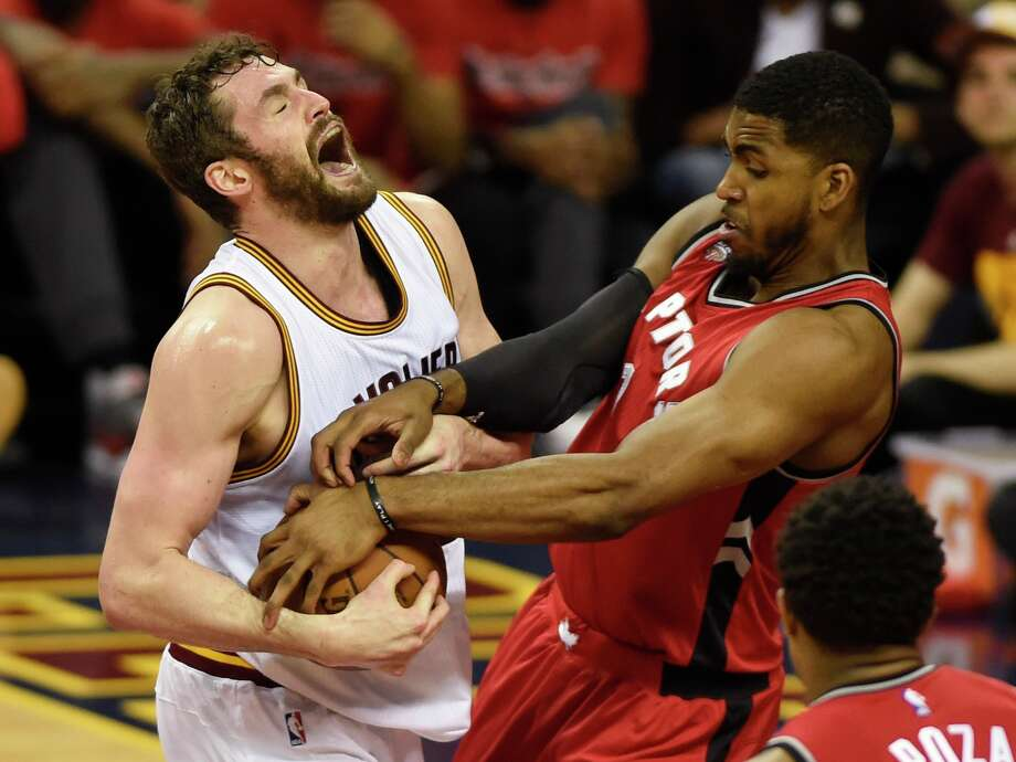 Cleveland Cavaliers forward Kevin Love tries to keep the ball from Toronto Raptors forward Patrick Patterson, right, during the second half of Game 2 of the NBA basketball Eastern Conference finals Thursday, May 19, 2016, in Cleveland. (Frank Gunn/The Canadian Press via AP)/Frank Gunn Photo: Frank Gunn, Associated Press / The Canadian Press