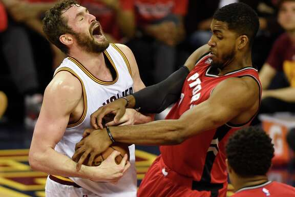 Cleveland Cavaliers forward Kevin Love tries to keep the ball from Toronto Raptors forward Patrick Patterson, right, during the second half of Game 2 of the NBA basketball Eastern Conference finals Thursday, May 19, 2016, in Cleveland. (Frank Gunn/The Canadian Press via AP)/Frank Gunn