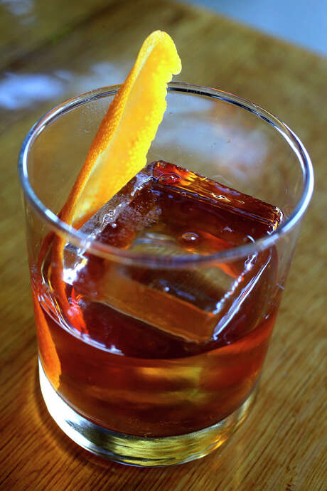 An Old Fashioned made with rye whiskey by bartender Roy Dutton at the Paramour bar. Photo: John Davenport /San Antonio Express-News / ©San Antonio Express-News/John Davenport