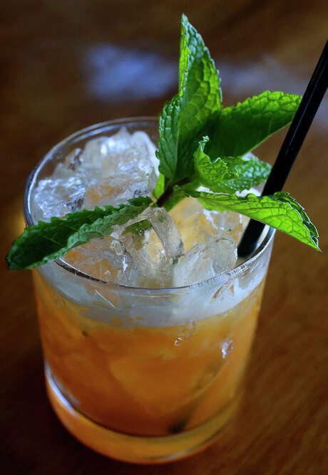 An Herbaceous Julep made with bourbon by bartender Roy Dutton at the Paramour bar. Photo: John Davenport /San Antonio Express-News / ©San Antonio Express-News/John Davenport