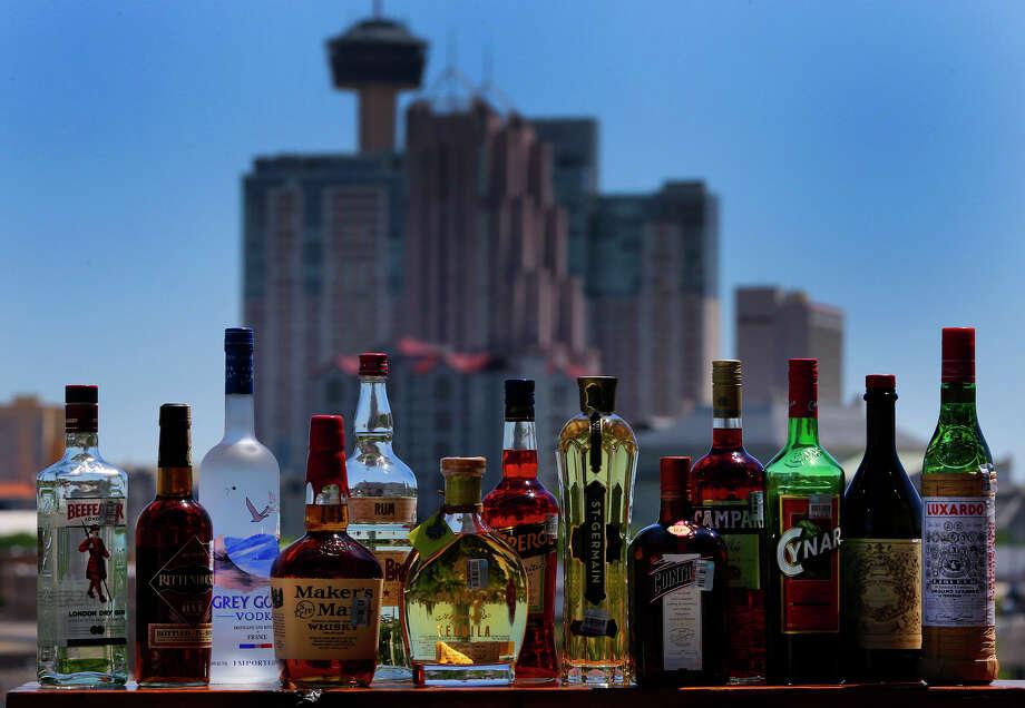 An array of liquors at Paramour bar Photo: John Davenport /San Antonio Express-News / ©San Antonio Express-News/John Davenport