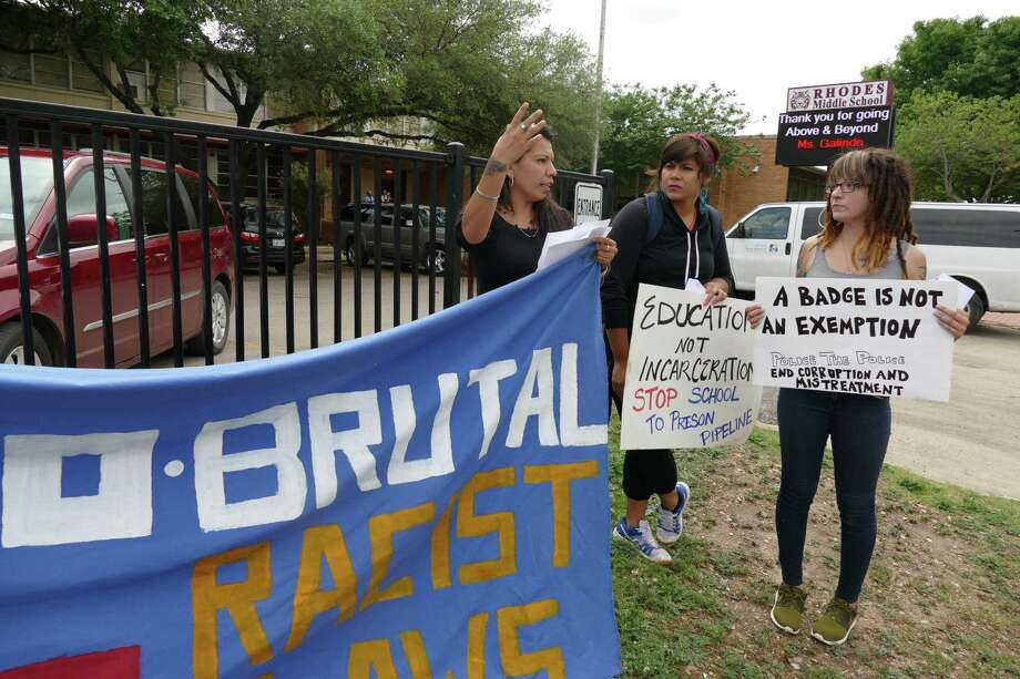 Protesters at Rhodes Middle School gather to show their concern on Wednesday, April, 13, 2016, over the incident involving officer Joshua Kehm, who threw 12-year-old student Janissa Valdez to the ground on March 29. Photo: Billy Calzada, Staff / San Antonio Express-News / San Antonio Express-News