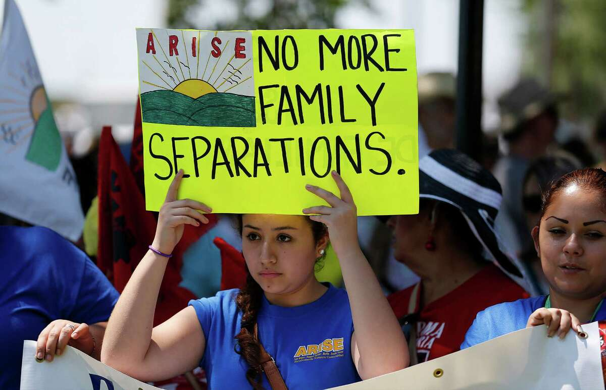 Jennifer Ramirez from the Rio Grande Valley area joins hundreds during the immigration detention march and protest in Dilley, Texas on Saturday, May 2, 2015. (Kin Man Hui/San Antonio Express-News)