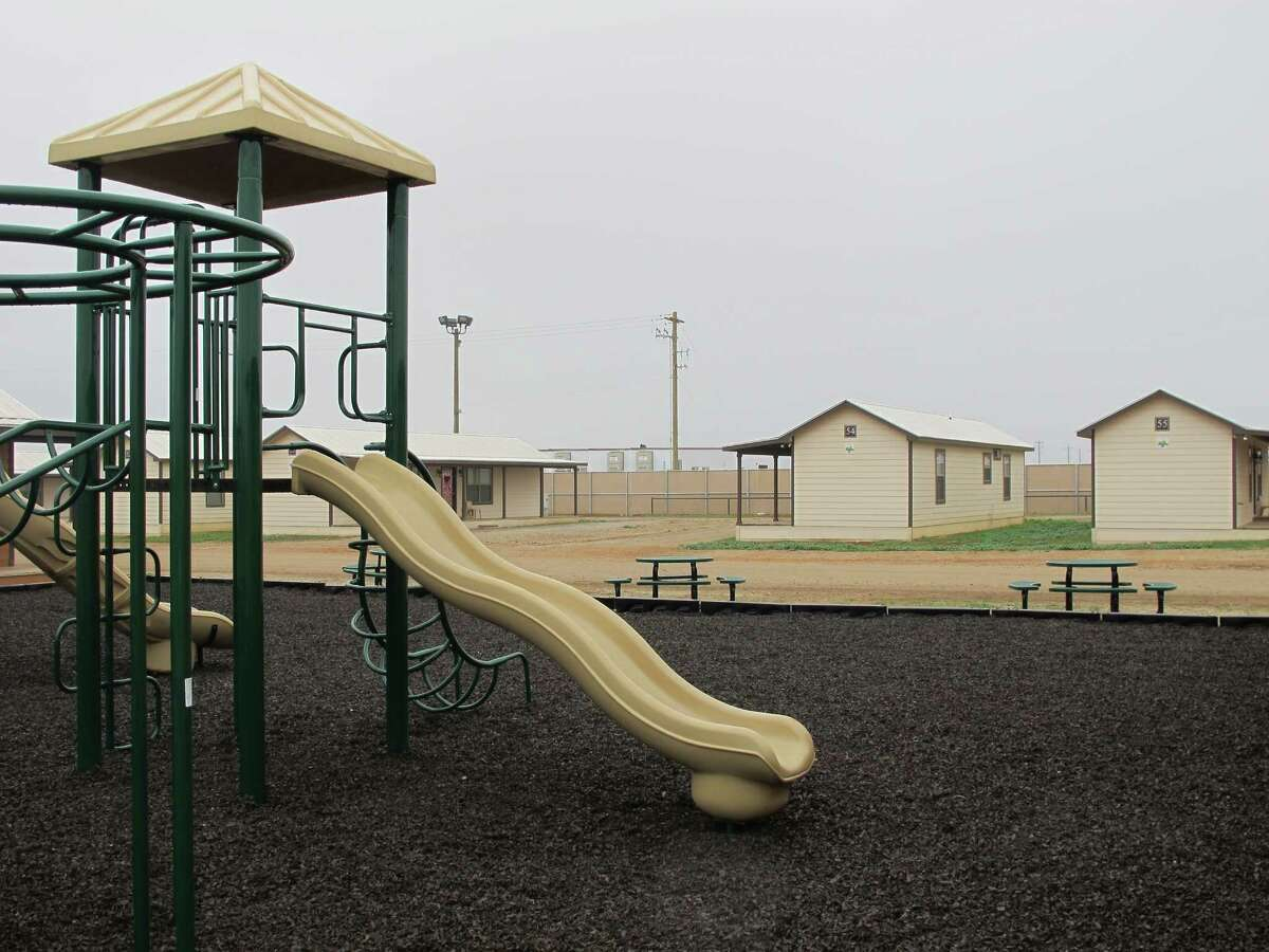 A playground surrounded by cottages that will house immigrants at a new family immigration detention center in Dilley, Texas, on Monday, Dec. 15, 2014. Opening following a summer surge of children crossing the U.S.-Mexico border illegally, the compound features cottages and will have an initial capacity of 480 growing to 2,400 around May _making it the nation's largest family immigration lockup. (AP Photo/Will Weissert)