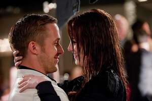 """In this film publicity image released by Warner Bros. Pictures, Ryan Gosling, left, and Emma Stone are shown in a scene from """"Crazy, Stupid, Love."""" (AP Photo/Warner Bros. Pictures, Ben Glass)"""