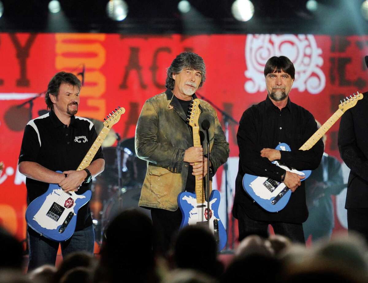 (L-R) Musicians Jeff Cook, Randy Owen and Teddy Gentry of the band Alabama accept the Greatest Hits Award onstage at the American Country Awards 2011 at the MGM Grand Garden Arena on December 5, 2011 in Las Vegas, Nevada. (Photo by Ethan Miller/Getty Images)