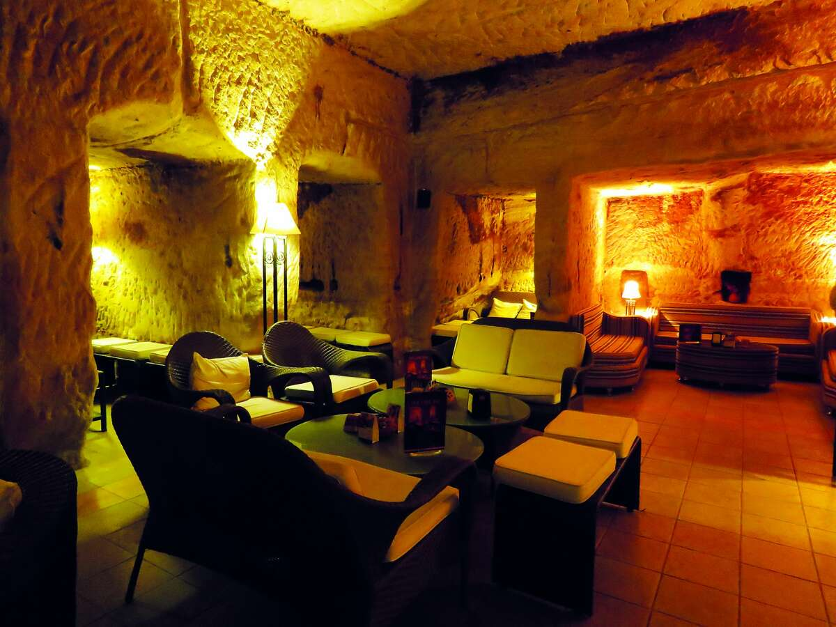 Cave Bar: Where: Petra, Jordan Built inside a 2000-year-old rock tomb, this is the world's oldest bar. The menu includes anything from familiar comfort foods to unique spirits.
