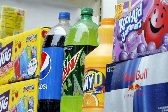 Beverages are displayed at a demonstration against a proposed sugary drinks tax, Wednesday, May 4, 2016, outside City Hall in Philadelphia. Former New York City Mayor Michael Bloomberg has�contributed an undisclosed sum to a nonprofit group starting an $825,000 ad campaign in support of a three-cents-per-ounce tax on soda and other sugary drinks. The American Beverage Association has already spent more than $1.5 million on an anti-tax campaign.  (AP Photo/Matt Rourke)