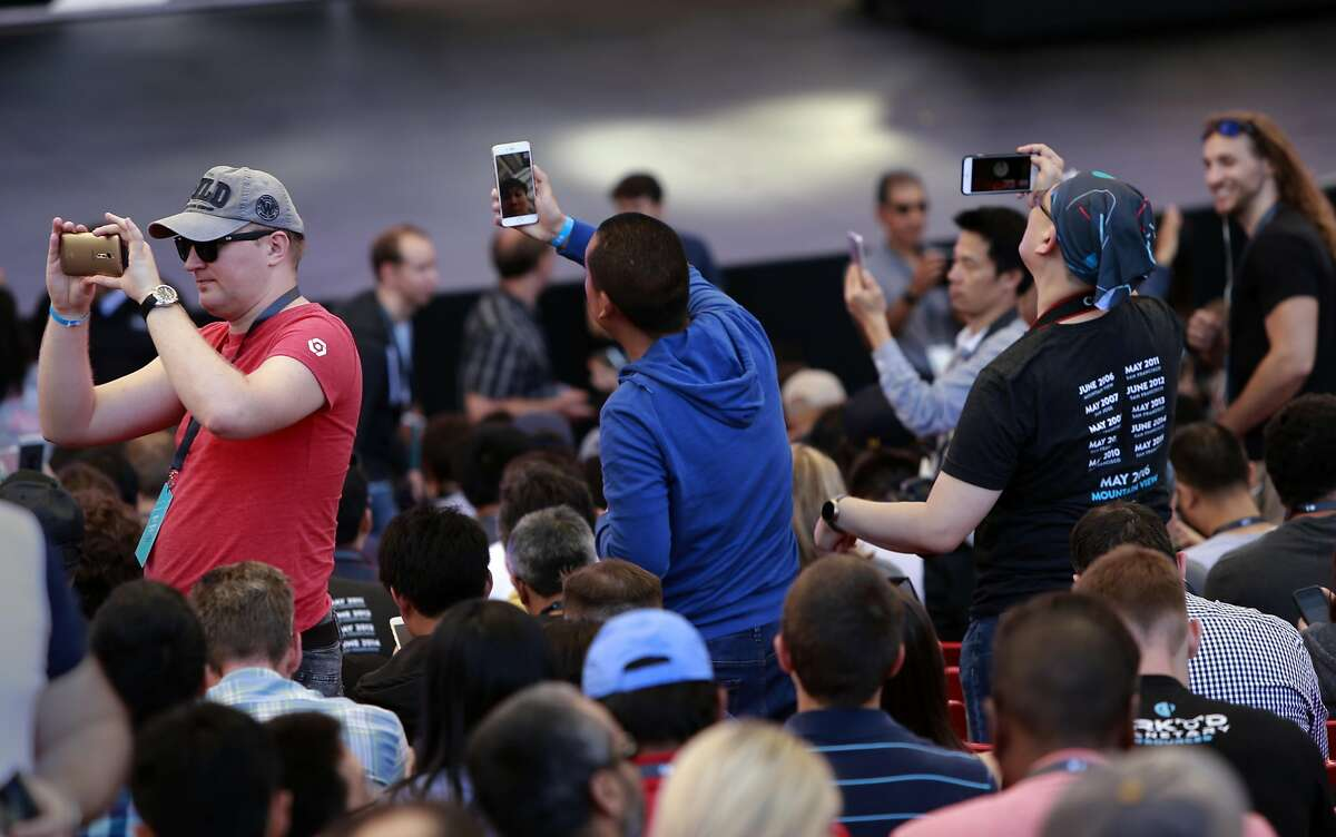 Attendees take a few selfies as they wait for the keynote address to begin at the 2016 Google I/O conference at the Shoreline Amphitheater in Mountain View, California, on Wed. May 18, 2016.