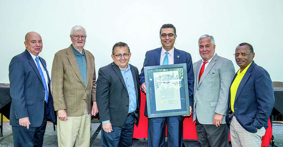 "Educators and civic leaders at the Latino Education Summit III: Working for Change event acknowledge May 3 as ""Texas Center for Hispanic Achievement Day"" with a proclamation from Houston Mayor Sylvester Turner. From left are: Lone Star College Chancellor Stephen C. Head; LSC board members Ron Trowbridge and Art Murillo; LSC-University Park President Shah Ardalan; American Latino Center for Research, Education & Justice President Richard R. Farias; and LSC board member Alton Smith."