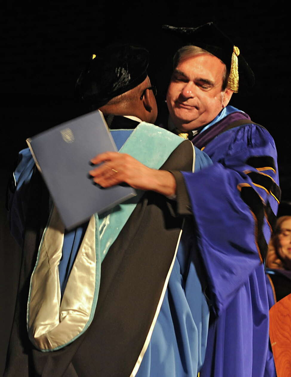 Schenectady Mayor Gary McCarthy, right, hugs Steady H. Moono during Moono's inauguration as Schenectady County Community College's seventh president at Proctors on Friday, May 13, 2016 in Schenectady, N.Y. (Lori Van Buren / Times Union)
