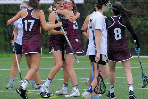 St. Luke's Emma Powless (21), center, celebrates a second half goal with teammates during Friday's 14-12 win over King in New Canaan on Friday.