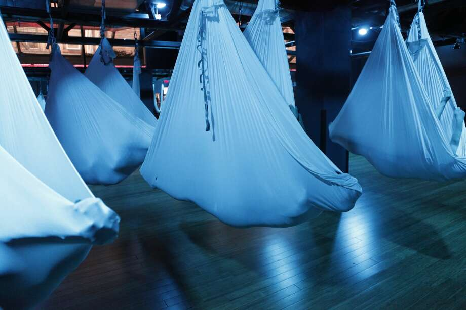 A class called AntiGravity Cocooning came to SF Crunch gyms in April. In it, members swaddle themselves in sling-style hammocks suspended from the ceiling. Photo: Leah Latella/The Wall Street Jou