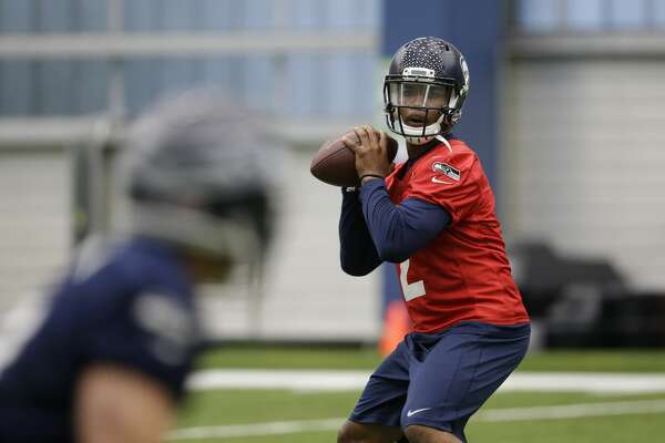 Seattle Seahawks quarterback Trevone Boykin passes during a rookie minicamp workout Sunday, May 8, 2016, in Renton, Wash. (AP Photo/Elaine Thompson)