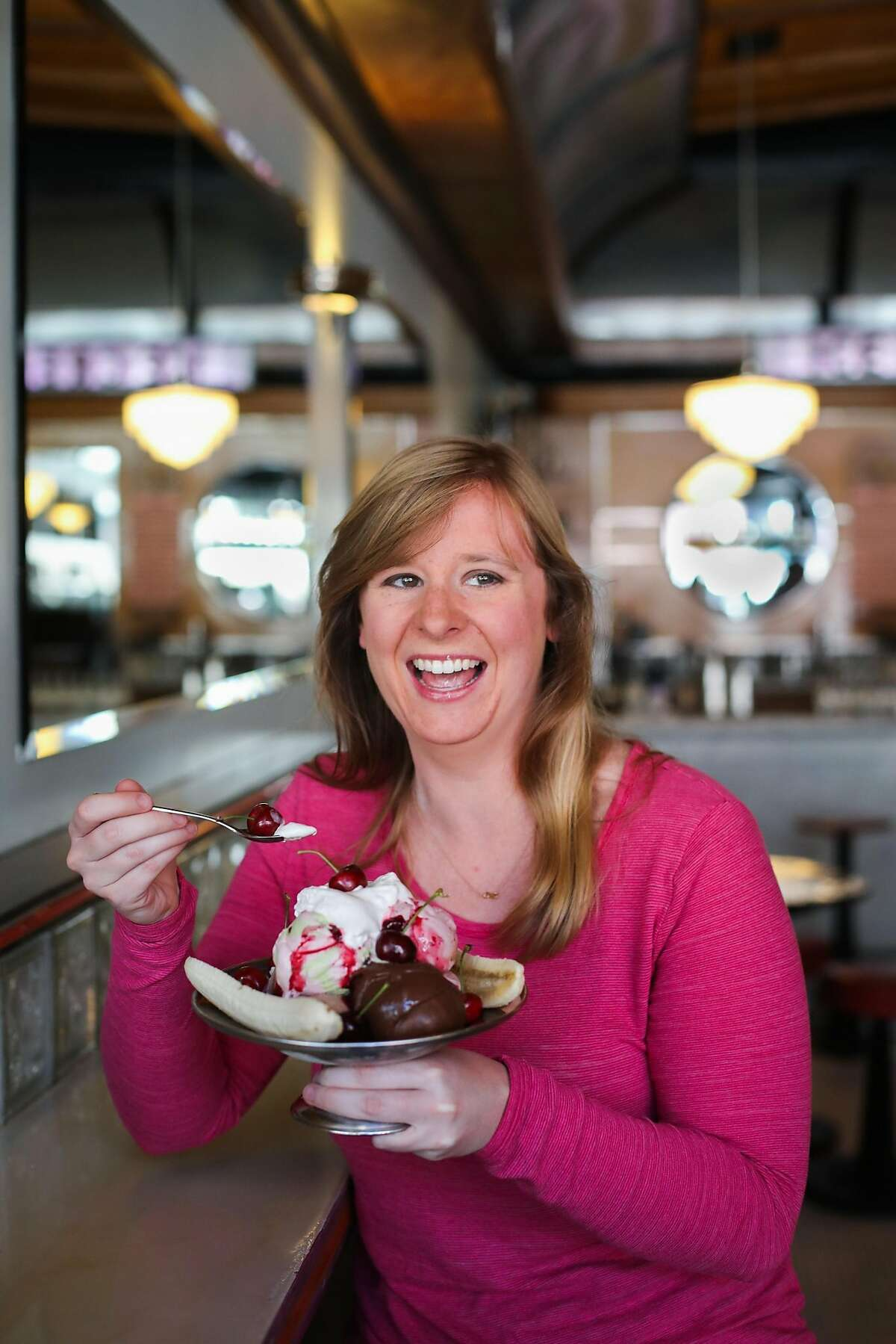 Brianna Rader, CEO of Juicebox, a sex education app, sits for a portrait while eating an ice cream sundae at the Ice Cream Bar in Cole Valley, in San Francisco, California, on Tuesday, May 17, 2016.