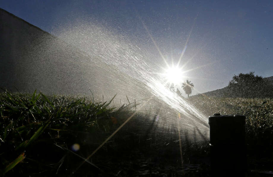 California will consider lifting a mandatory statewide water conservation order for cities and towns after a rainy, snowy winter eased the state's drought.