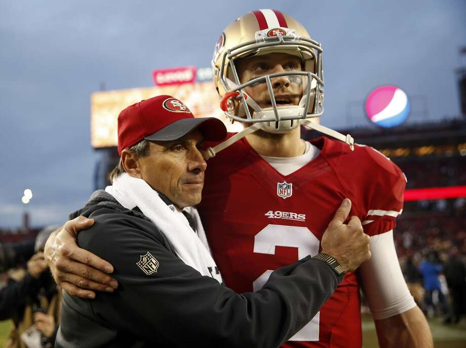 San Francisco 49ers' Blaine Gabbert hugs quarterbacks coach Steve Logan after Niners' 19-16 win over St. Louis Rams in overtime in NFL game at Levi's Stadium in Santa Clara, Calif., on Sunday, January 3, 2016. Photo: Scott Strazzante, The Chronicle