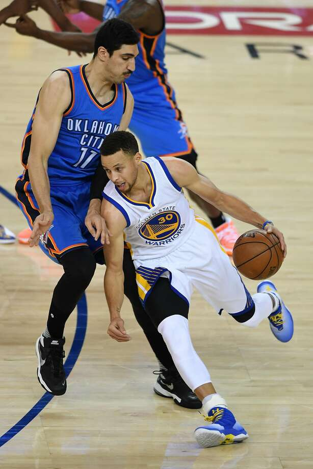 OAKLAND, CA - MAY 16:  Stephen Curry #30 of the Golden State Warriors drives with the ball against Enes Kanter #11 of the Oklahoma City Thunder during game one of the NBA Western Conference Final at ORACLE Arena on May 16, 2016 in Oakland, California. NOTE TO USER: User expressly acknowledges and agrees that, by downloading and or using this photograph, User is consenting to the terms and conditions of the Getty Images License Agreement.  (Photo by Thearon W. Henderson/Getty Images) Photo: Thearon W. Henderson, Getty Images