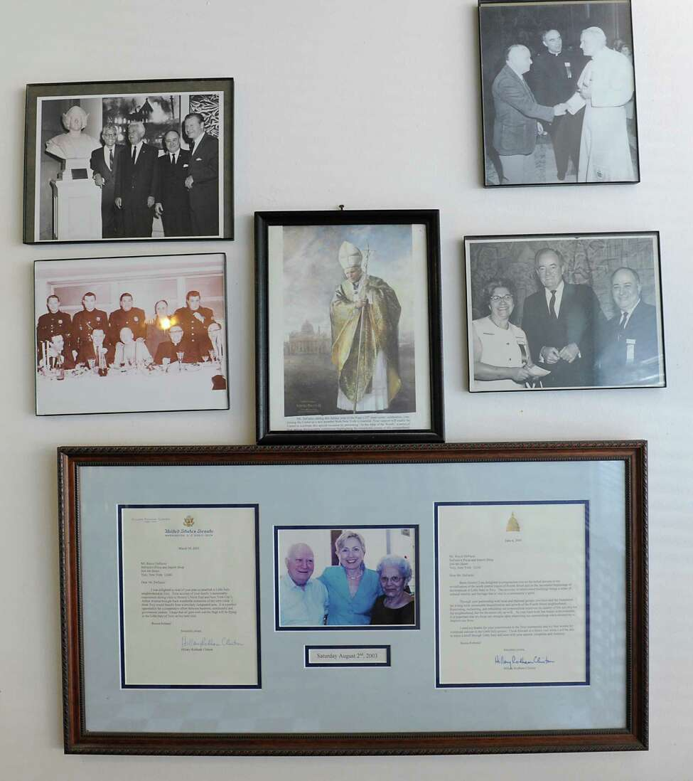 Photos of or taken by Anthony DeFazio hang on the wall in DeFazio's pizzeria in the Little Italy neighborhood on Thursday, May 12, 2016 in Troy, N.Y. The bottom is a photo of Anthony and his wife Josephine with Hillary Clinton. (Lori Van Buren / Times Union)
