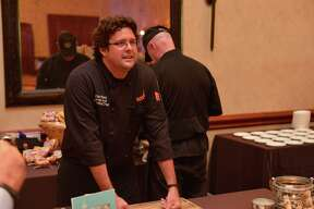 Chef Brian West of Smoke: The Restaurant looks over the crowd during the Express-News Top 100 Dining and Drinks event at the La Cantera Resort & Spa.