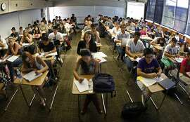 """Every desk is taken in professor Jeanne Neil's Accounting 101 classroom at Orange Coast Community College in Costa Mesa, California, on September 10, 2011. She said dozens more students were left on the """"wait list"""" after the beginning business course reached capacity enrollment. (Don Bartletti/Los Angeles Times/MCT)"""