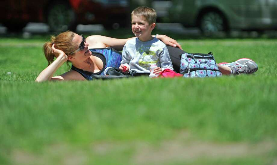 Sarah DiSiena of Gansevoort and her son, Carter, four, enjoy lunch on the grass in Congress Park on Wednesday, May 18, 2016, in Saratoga Springs, N.Y.  (Paul Buckowski / Times Union) Photo: STAFF / 40036656A