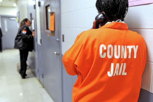 An inmate makes a phone call from the Jefferson County Jail in 2011.  Guiseppe Barranco/The Enterprise