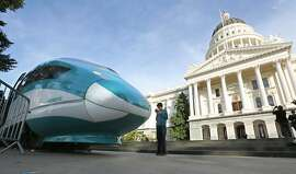 FILE - In this Feb. 26, 2015 file photo, a full-scale mock-up of a high-speed train is displayed at the Capitol in Sacramento, Calif. The board that oversees California�s massive high-speed rail project is meeting in Sacramento on Thursday afternoon, April 28, 2016, to consider a new $64 billion business plan. The updated plan calls for a station in Merced and the first stretch to go from the Central Valley to the San Jose area. (AP Photo/Rich Pedroncelli, File)