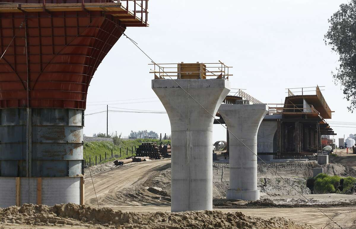 FILE --In this Feb. 26, 2016 file photo, the supports for a 1,600-foot-viaduct to carry high-speed rail trains across the Fresno River are seen under construction near Madera, Calif. The California High Speed Rail Authority board is meeting Thursday, April 21, 2016, to adopt its latest plan for the project, which proposes dramatic changes to the route. (AP Photo/Rich Pedroncelli,File)