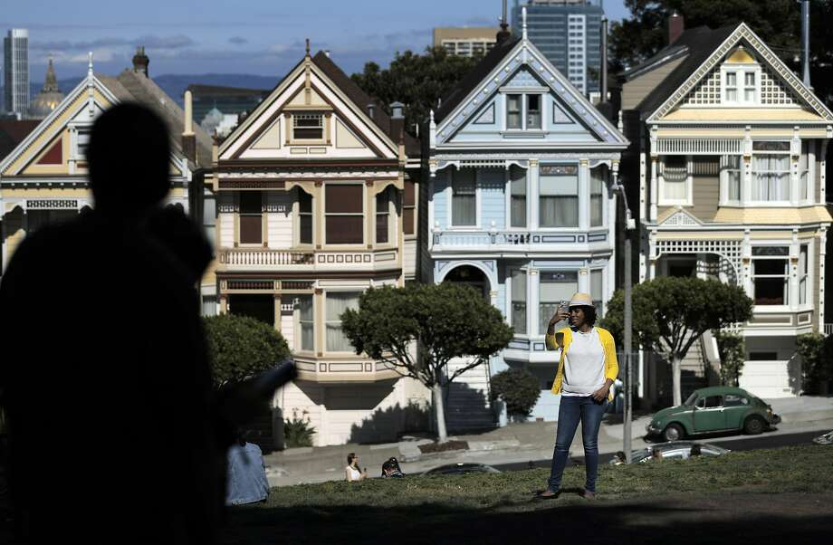 Malika Lipscomb, from Brooklyn, takes a selfie in front of the Painted Ladies at Alamo Square Park in San Francisco on Sunday, May 8, 2016. Photo: Carlos Avila Gonzalez, The Chronicle