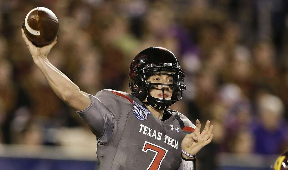 FILE - In this Dec. 30, 2013 file photo, Texas Tech quarterback Davis Webb throws a pass during his record setting first half against Arizona State in the Holiday Bowl NCAA college football football game in San Diego. Texas Tech opens the season on Saturday when they host Central Arkanas. (AP Photo/Gregory Bull, File) Photo: Gregory Bull, Associated Press