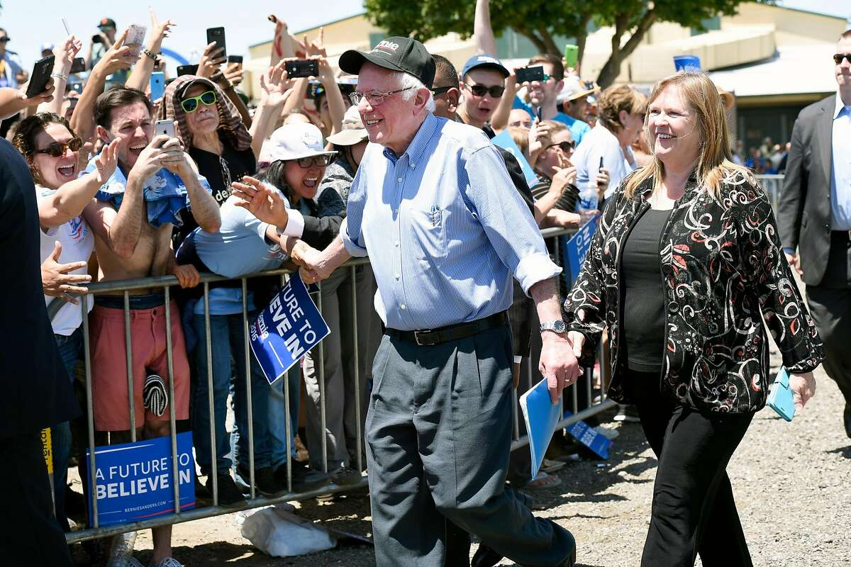 Democratic presidential hopeful Bernie Sanders and his wife Jane O�Meara Sanders greet fans as they head towards the stage during a rally at the Santa Clara County Fairgrounds in San Jose, CA Wednesday, May 18th, 2016.