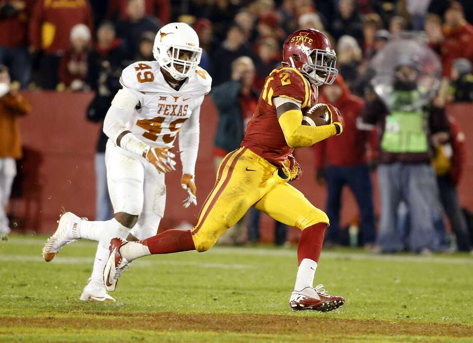 AMES, IA - OCTOBER 31: Running back Mike Warren #2 of the Iowa State Cyclones rushes for yards as defensive end Derick Roberson #49 of the Texas Longhorns defends in the second half of play at Jack Trice Stadium on October 31, 2015 in Ames, Iowa. Iowa State defeated Texas 24-0. (Photo by David K Purdy/Getty Images) Photo: Getty Images