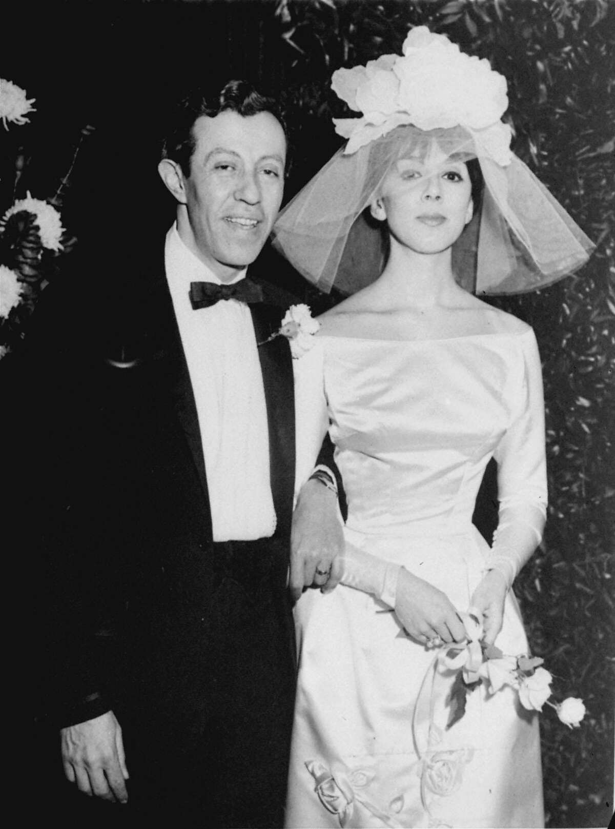 """** FILE ** Broadway playwright Adolph Green and his bride, 26 year old actress Phyllis Newman, are shown after their wedding in this Jan. 31, 1960 file photo in New York. Green, a lyricist whose six-decade collaboration with Betty Comden helped create such joyous stage celebrations of New York as """"On the Town'' and """"Wonderful Town'' as well as the classic movie musical """"Singin' in the Rain,'' has died late Wednesday, Oct. 23, 2002 at his home in Nw York. He was 87. (AP Photo/File)"""