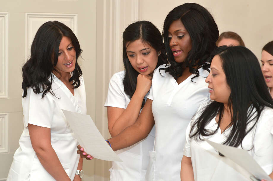 Stamford's Paula Ferriana, Marjorie Escala, Melissa Emilcar and Ketaki Desai rehearse before  Norwalk Community College Nursing Class of 2016 Pinning Ceremony at City Hall in Norwalk Conn. Tuesday May 17, 2016 Photo: Alex Von Kleydorff, Hearst Connecticut Media / Connecticut Post
