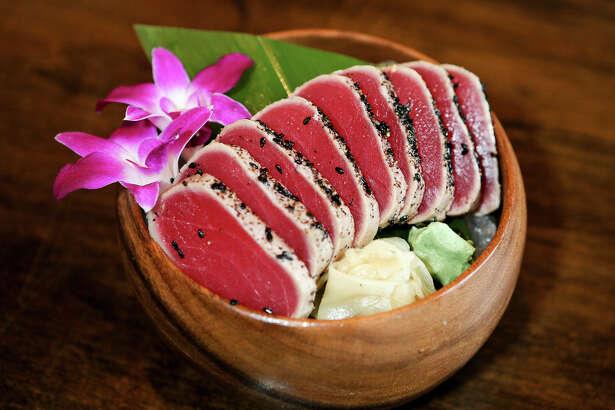 Tuna tataki features a pepper-crusted tuna steak that's lightly seared.