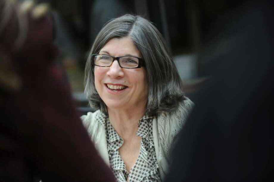 """Best-selling author Anna Quindlen smiles while she autographs her new book, """"Every Last One,"""" at Greenwich Library, on Monday, April 19, 2010. Photo: Helen Neafsey / Greenwich Time"""