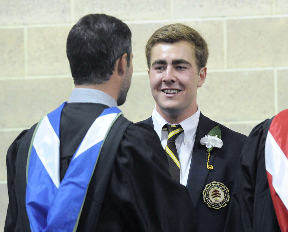 James MacFarlane, right, smiles during his Brunswick School commencement at the school in Greenwich, Conn., Wednesday, May 18, 2016. Educator, author, activist and former National Football League player Joe Ehrmann was the commencement speaker. Photo: Bob Luckey Jr., Hearst Connecticut Media / Greenwich Time