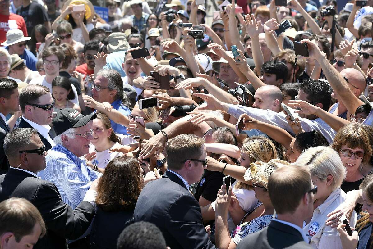 Democratic presidential hopeful Bernie Sanders, left, greets fans following a rally at the Santa Clara County Fairgrounds in San Jose, CA Wednesday, May 18th, 2016.