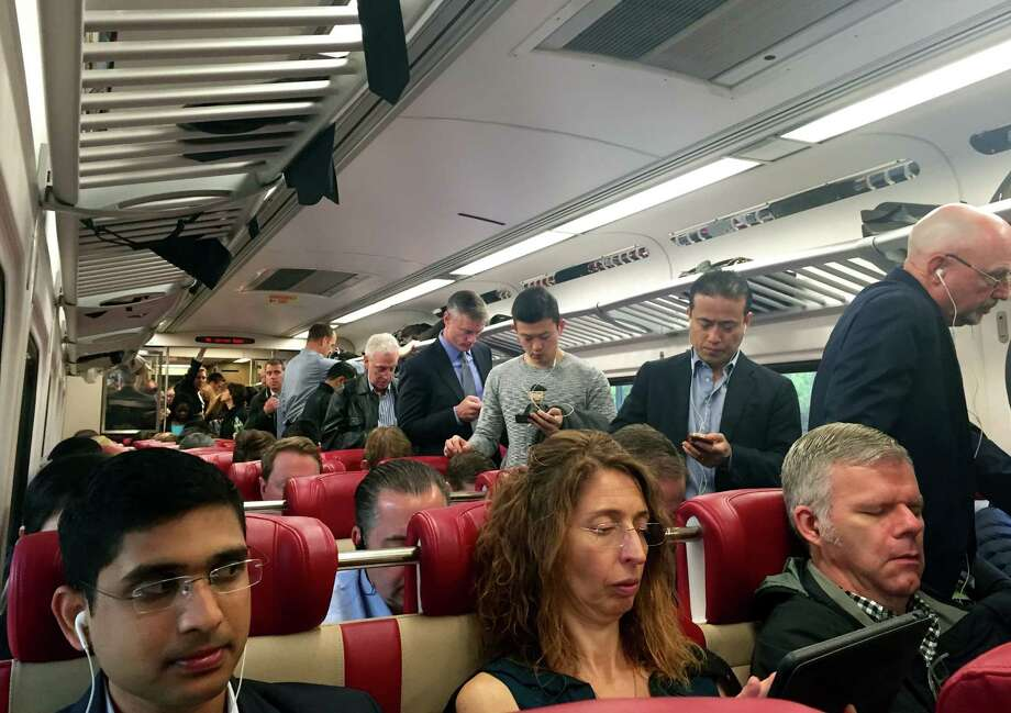 Commuters crowd onboard the 6:57 a.m. Metro-North train out of Stamford, Conn. Wednesday, May 18, 2016,  after a fire severely damaged a viaduct near 125th Street in Harlem. Photo: Jon Lucas, Contributed Photo / Connecticut Post contributed