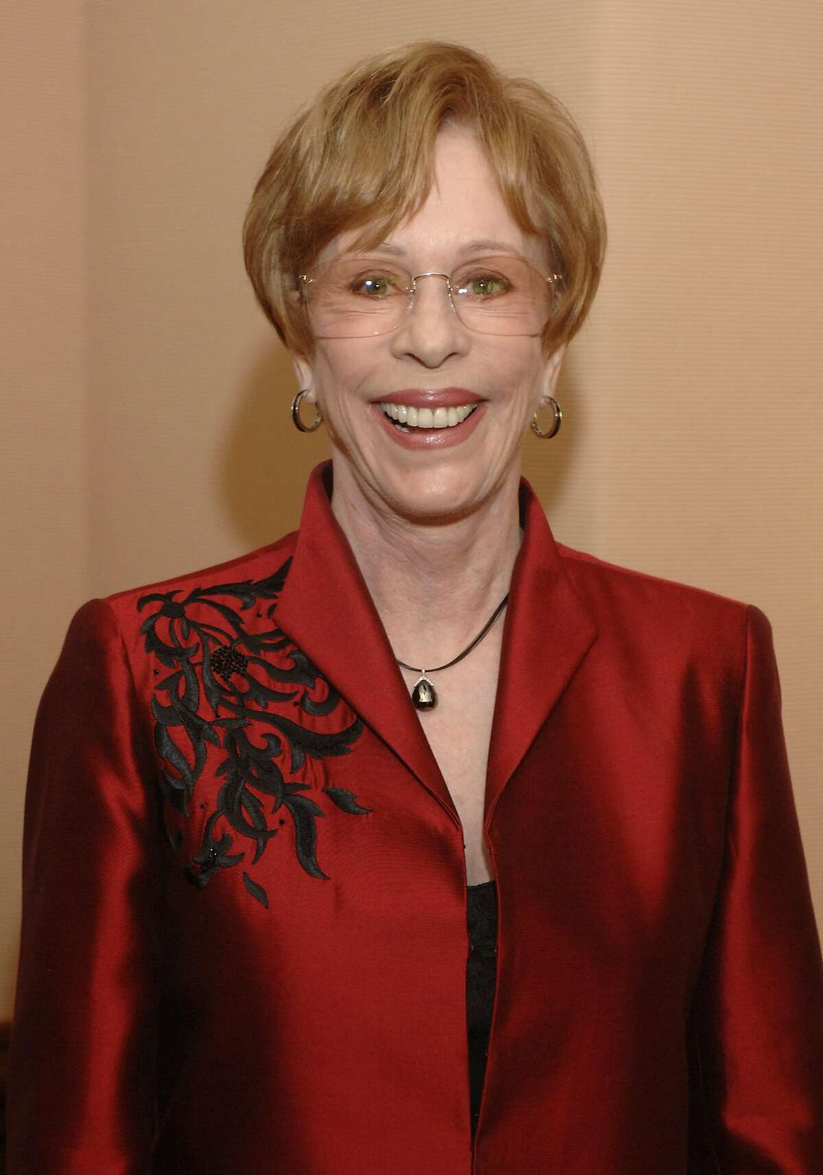 """Carol Burnett is shown in this July 23, 2006, file photo in Pasadena, Calif. Burnett has filed a $2 million copyright infringement lawsuit against 20th Century Fox, claiming her cleaning woman character was portrayed on the animated series """"Family Guy."""" The U.S. District Court lawsuit, which was filed Thursday,March 15, 2007, said the Fox show didn't have the 73-year-old comedian's permission to include her cleaning woman character, Charwoman, in an April 2006 episode. (AP Photo/Phil McCarten, file)"""