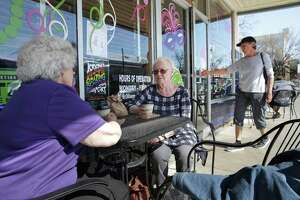 Billy Ann Dudley (left) and Patricia Talbert relax and chat on the sidewalk in front of Naegelin's Bakery in New Braunfels on February 16, 2016.  Nagelins is touted as the oldest bakery in Texas.