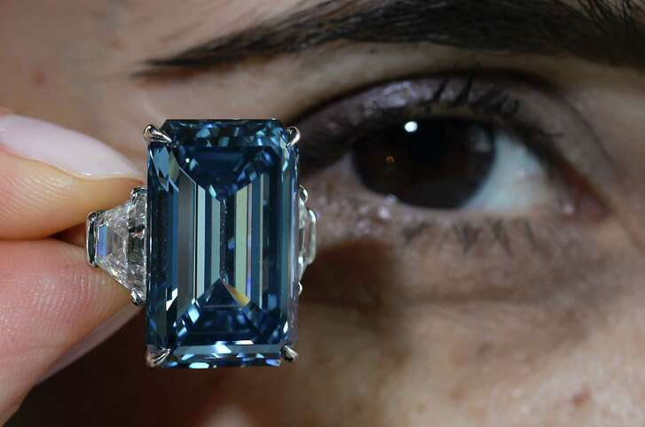 The Oppenheimer Blue, a dazzling blue diamond, fetched a record $58 million at auction in Geneva. Blue diamonds are the rarest in the world.